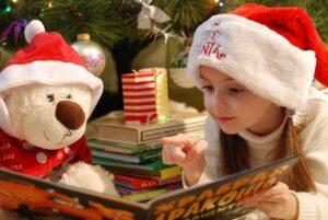 girl reading a Christamas book