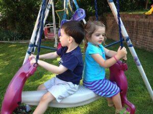 daycare kids on a swing